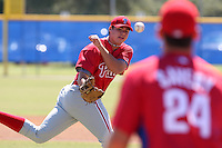 Philadelphia Phillies minor league pitcher Jesse Biddle (43) makes a play off the mound throwing to first baseman Joe Savery (24) to record the out vs. the Toronto Blue Jays in an Instructional League game at Englebert Minor League Complex in Dunedin, Florida;  October 7, 2010.  Biddle was taken in the 1st round, 27th overall, out of Germantown Friends High School in Philadelphia, PA.  Photo BY Mike Janes/Four Seam Images