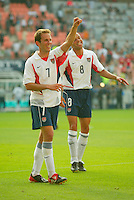 Eddie Lewis celebrates after the game with Earnie Stewart behind him. The USA defeated Mexico 2-0 in the Round of 16 of the FIFA World Cup 2002 in South Korea on June 17, 2002.