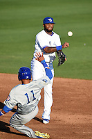Dunedin Blue Jays shortstop Jose Reyes (7) - on rehab assignment from the Toronto Blue Jays - turns a double play during a game against the Daytona Cubs on April 16, 2014 at Florida Auto Exchange Stadium in Dunedin, Florida.  Dunedin defeated Daytona 5-1.  (Mike Janes/Four Seam Images)