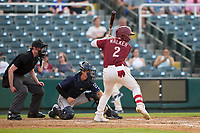 Frisco RoughRiders Steele Walker (2) bats in front of catcher Chandler Seagle (5) and umpire Darius Ghani during a game against the San Antonio Missions on June 25, 2021 at Dr. Pepper Ballpark in Frisco, Texas.  (Ken Murphy/Four Seam Images)