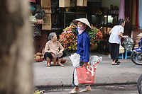 Hanoi<br /> , Vietnam - 2007 File Photo -<br /> <br /> <br /> <br /> A woman wearing a scarf to protect from pollution carries a bag loaded her grocery, in Hanoi.<br /> <br /> <br /> photo : James Wong-  Images Distribution