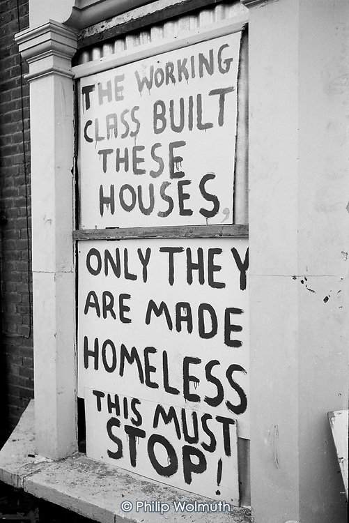 The Working Class Built these Houses.  Graffiti on a boarded up house in North Paddington, London.