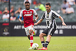 Juventus' player Grigoris Kastanos battles South China's player Mahama Awai for the ball during the South China vs Juventus match of the AET International Challenge Cup on 30 July 2016 at Hong Kong Stadium, in Hong Kong, China.  Photo by Marcio Machado / Power Sport Images
