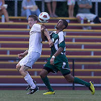 George Mason University forward Richard Diaz (21) attempts to control the ball while moving forward as Boston College defender Ryan Dunn (3) defends. Boston College defeated George Mason University, 3-2, at Newton Soccer Field, August 26, 2011.