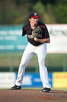 Kannapolis Intimidators starting pitcher Zach Thompson (40) looks to his catcher for the sign against the Hagerstown Suns at Intimidators Stadium on July 18, 2015 in Kannapolis, North Carolina.  The Intimidators defeated the Suns 1-0.  (Brian Westerholt/Four Seam Images)