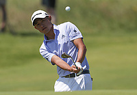 16th July 2021; Royal St Georges Golf Club, Sandwich, Kent, England; The Open Championship Tour Golf, Day Two; Collin Morikawa (USA) hits his third shot at the par four 15th hole