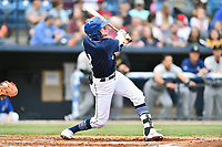 Asheville Tourists left fielder Will Golsan (8) homers in the first inning of a game against the West Virginia Power at McCormick Field on April 18, 2019 in Asheville, North Carolina. The Power defeated the Tourists 12-7. (Tony Farlow/Four Seam Images)