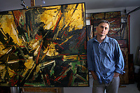 Samir Biscevic, a Bosnian artist whose work focuses on the war atrocities in his homeland, lives and paints on the northwest side.