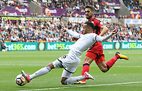 Martin Olsson of Swansea City crosses the ball into the box during the Premier League match between Swansea City and Huddersfield Town at The Liberty Stadium, Swansea, Wales, UK. Saturday 14 October 2017