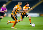 Hull City's George Honeyman runs with ball, alongside Josh Magennis, a long exposure with motion blur. Hull 2 Sunderland 2, League One 20th April 2021.