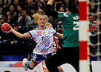 BELGRADE, SERBIA - DECEMBER 16:  Jelena Nisavic (L) of Serbiajump to shoot near Eva Kiss (R) of Hungary during the Women's European Handball Championship 2012 third place match between Hungary and Serbia at Arena Hall on December 16, 2012 in Belgrade, Serbia. (Photo by Srdjan Stevanovic/Getty Images)