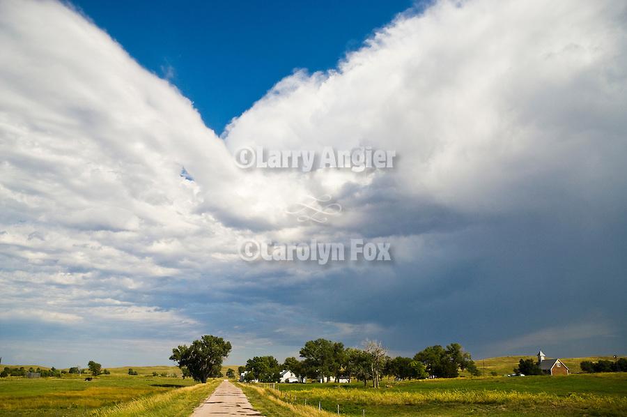An afternoon thunderstorm builds overhead in the Sand Hills over Eli, Nebraska.