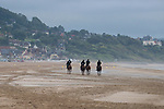 August 16, 2021, Deauville (France) - Racehorses training at the beach in Deauville. [Copyright (c) Sandra Scherning/Eclipse Sportswire)]