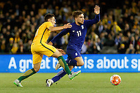 June 7, 2016: CHRISTOPHER IKONOMIDIS (11) of Australia  and KONSTANTINOS STAFYLIDIS (11) of Greece fight for the ball during an international friendly match between the Australian Socceroos and Greece at Etihad Stadium, Melbourne. Photo Sydney Low