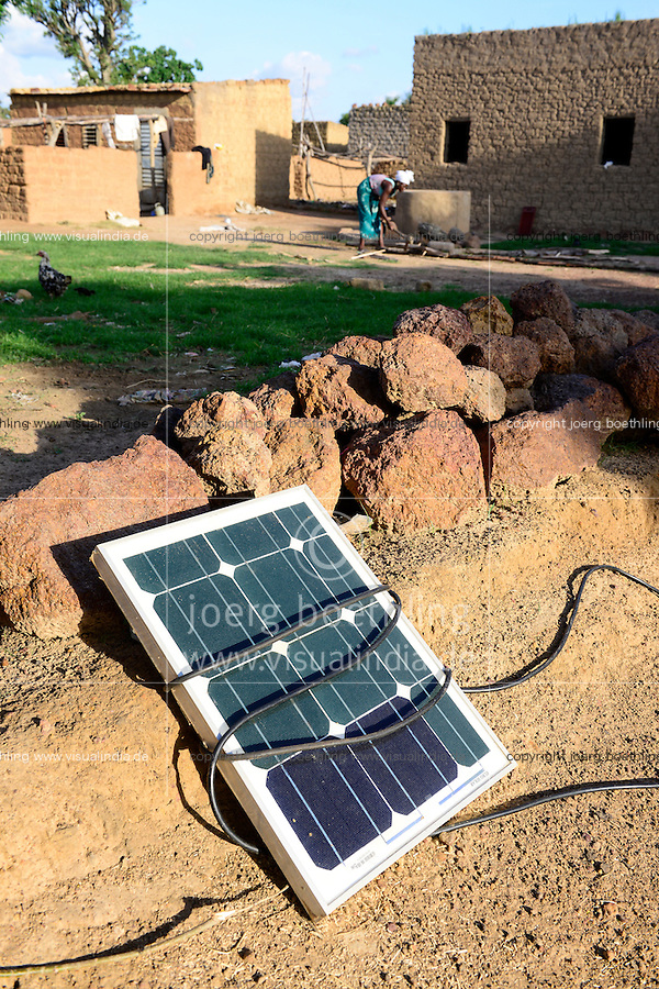 BURKINA FASO, Bobo Dioulasso, village Bama, solar home system, PV panel in the sun to charge the battery / Dorf Bama, Solar Panel in der Sonne zum Aufladen der Batterie