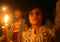 "Palestinian children hold candles during a demonstration organized by civilians protesting against Israeli sanctions on the Gaza Strip, in front of the United Nation headquarters in Gaza City, Thursday, Nov. 1, 2007. Earlier this week, Israel's attorney general held up the government's plan to cut back electricity supplies to Gaza, demanding more work be done to prevent humanitarian harm. Palestinians in Gaza rely on Israel for all of their fuel and more than half of their electricity.""photo by Fady Adwan"""