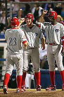 April 10th 2009:  First baseman Matthew Rizzotti (left) and Right Fielder Domonic Brown (right) of the Clearwater Threshers, Florida State League Class-A affiliate of the Philadelphia Phillies, greet Tim Kennelly after Joel Naughton hit a grand slam home run in the top of the 7th inning during a game at Dunedin Stadium in Dunedin, FL.  Photo by:  Mike Janes/Four Seam Images