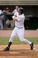 Aaron Bray #15 of the Greeneville Astros follows through on his swing versus the Danville Braves at Pioneer Park June 28, 2009 in Greeneville, Tennessee. (Photo by Brian Westerholt / Four Seam Images)