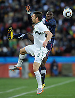 Jozy Altidore of USA and Bostjan Cesar (5) of Slovenia. USA tied Slovenia 2-2 in the 2010 FIFA World Cup at Ellis Park in Johannesburg, South Africa on June 18th, 2010.