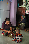 INDIA (West Bengal - Calcutta)July 2007,Shakila Babe helping her mother in household work at their  small two roomed apartment in Iqbalpur.  10 family members share this apartment.   Shakila and Shanno are twins from a poor muslim family of Iqbalpur, Kolkata. . Inspite of their late father's unwillingness to send his daughters to take up  boxing her mother Banno Begum inspired them to take up boxing at the age of 3. Their father was more concerned about the social stigma they have in their community regarding women coming into sports or doing anything which may show disrespect to the religious emotions of his community. Shakila now has been recognised as one of the best young woman boxers of the country after she won the  international championship at Turkey in the junior category. Shanno is also been called for the National camp this year. Presently Shakila and shanno has become the role model in the Iqbalpur area  and parents from muslim community of Iqbalpur have started showing interst in boxing. Iqbalpur is a poor muslim dominated area mostly covered with shanty town with all odds which comes along with poverty and lack of education. - Arindam Mukherjee