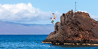 Two adventurers jump off Black Rock at Ka'anapali Beach on Maui.