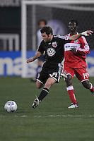 DC United midfielder Ben Olsen (14) makes a pass.   Chicago Fire tied DC United 1-1 at  RFK Stadium, Saturday March 28, 2009.