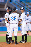 Hudson Valley Renegades pitching coach Jorge Moncada (32) has a chat on the mound with pitcher Edgar Gomez (37) and catcher Mac James (9) during the game against the Brooklyn Cyclones at Dutchess Stadium on June 18, 2014 in Wappingers Falls, New York.  The Cyclones defeated the Renegades 4-3 in 10 innings.  (Brian Westerholt/Four Seam Images)