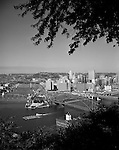 Pittsburgh PA:  View of Pittsburgh with Tugboat taking barges down the Ohio River.