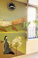 Switzerland. Bern. Regionalfgefängnis. Jail. Detention awaiting trial (commital for trial or pending trial). Loss of liberty. On the second floor near a window with bars, a mural painting of a woman watering plants in a landscape. © 2005 Didier Ruef