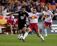 Josh Wolff (16) of D.C. United makes his way past Dwayne De Rosario (11) of the New York Red Bulls during the game at RFK Stadium in Washington, DC.  D.C. United lost to the New York Red Bulls, 4-0.