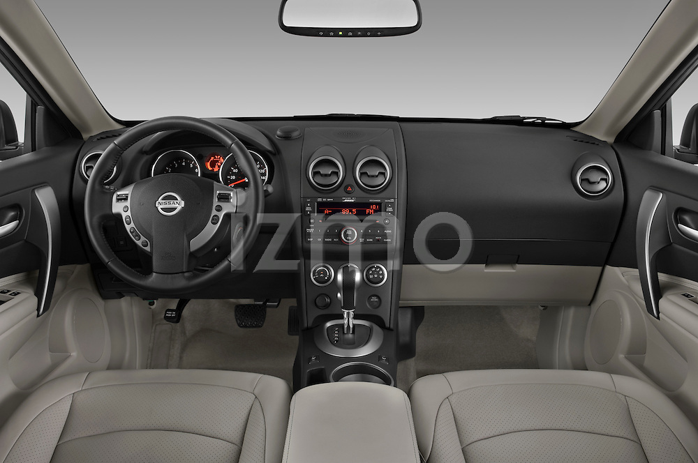 Straight dashboard view of a 2009 Nissan Rogue SL.