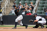 Victor Fernandez (37) of the West Virginia Power follows through on his swing against the Kannapolis Intimidators at Kannapolis Intimidators Stadium on June 18, 2017 in Kannapolis, North Carolina.  The Intimidators defeated the Power 5-3 to win the South Atlantic League Northern Division first half title.  It is the first trip to the playoffs for the Intimidators since 2009.  (Brian Westerholt/Four Seam Images)