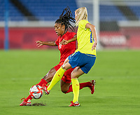YOKOHAMA, JAPAN - AUGUST 6: Ashley Lawrence #10 of Canada tackles Sofia Jakobsson #10 of Sweden during a game between Canada and Sweden at International Stadium Yokohama on August 6, 2021 in Yokohama, Japan.