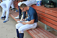 Second baseman Chandler Avant (5) of the Columbia Fireflies makes notes on every at bat in a journal during a game against the Rome Braves on Tuesday, June 4, 2019, at Segra Park in Columbia, South Carolina. Columbia won, 3-2. (Tom Priddy/Four Seam Images)