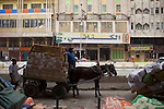 BAGHDAD, IRAQ: A man moves goods through the streets with a horse and cart in the old Shorja market in Baghdad...Despite an increase in violence across Iraq, daily life continues as normal in Baghdad...Photo by Ali Arkady/Baghdad