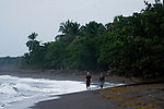 Jaguar (Panthera onca) biologists, Stephanny Arroyo-Arce and Ian Thomson, walking down beach to check for predated sea turtles, Coastal Jaguar Conservation Project, Tortuguero National Park, Costa Rica