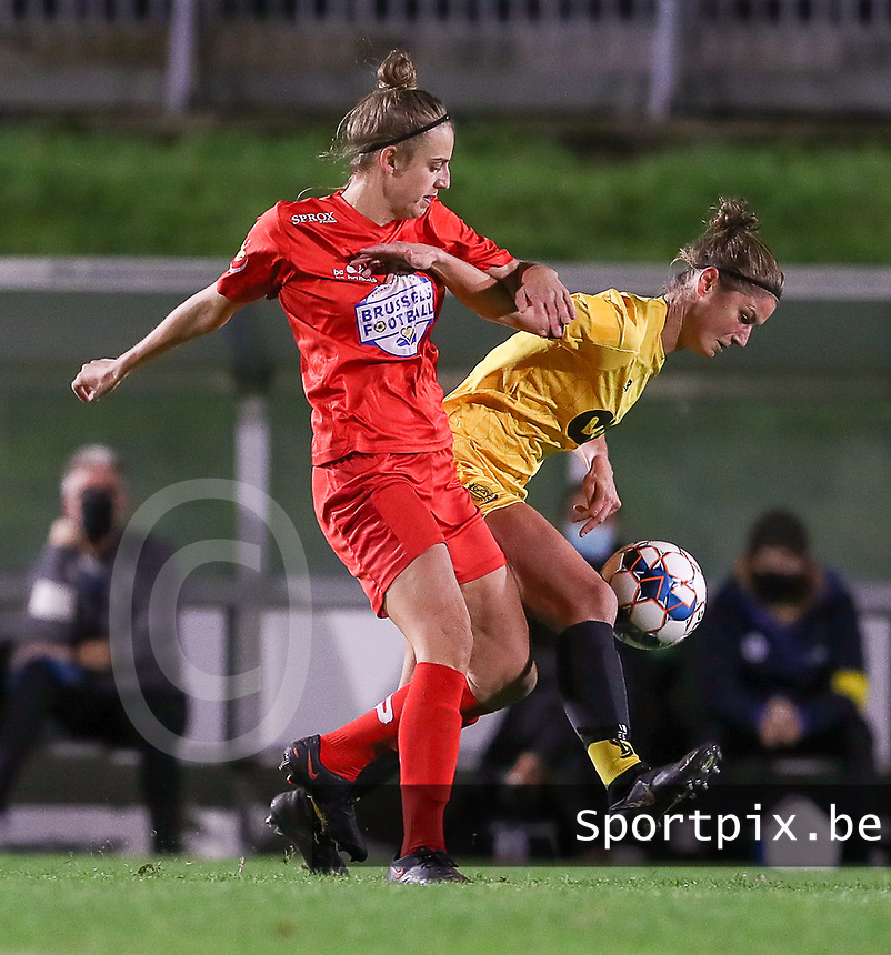 Woluwe's Sheila Broos (20) (L) and Standard's Ellen Charlier (13) (R) in action during a female soccer game between FC Femina WS Woluwe and Standard Femina de Liege on the fourth match day of the 2020 - 2021 season of Belgian Womens Super League , Friday 8th of October 2020  in Liege , Belgium . PHOTO SPORTPIX.BE | SPP | SEVIL OKTEM