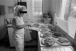 HM Prison Styal Wilmslow Cheshire UK 1980s. Womens prison,female prisoner cooking lunch for her wing inmates.  Cheshire 1986