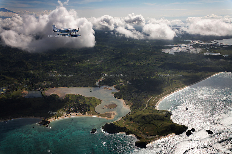 Aerials of Batu Hijau gold mine and Benete seaport and concentrator and pipeline that takes tailings into ocean trench.
