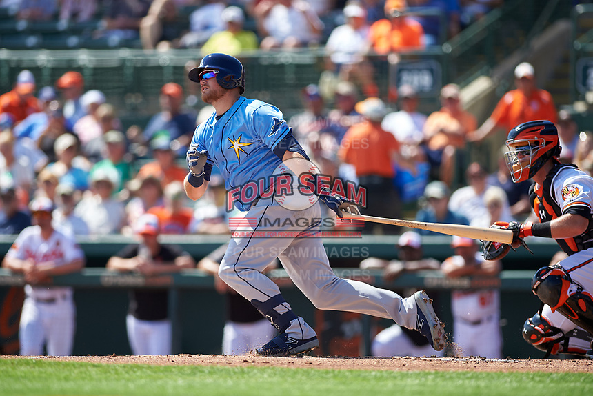 Tampa Bay Rays third baseman Christian Arroyo (22) follows through on a swing during a Grapefruit League Spring Training game against the Baltimore Orioles on March 1, 2019 at Ed Smith Stadium in Sarasota, Florida.  Rays defeated the Orioles 10-5.  (Mike Janes/Four Seam Images)