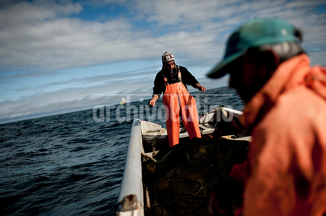 """Photo Essay on the life of the people Lafkenche, a part of the Mapuche indian nation from Southern Chile. Lafkenche mean """"peple from the sea"""", they live from Bio-Bio river towards the southern coast of the country, making a living as fishermen. Their traditions are strong and new groups of them are organizing to preserve their identityBonifacio cove, XIV Region of the Rivers. December 29, 2012. <br /> In Tonina, fiber boat of Miguel Barrientos takes 6 hours without catching anything."""
