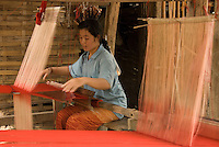 A woman weaving in intricate detail in a small secluded hilltop village outside of Luang Prabang, Laos.