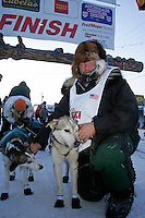 Thursday  March 15, 2007   ---- Nome, Alaska.   Sonny Lindner poses with his lead dogs in Nome after finishing the Iditarod in   25th  place.