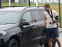 Swansea City's Fernando Llorente arrives with a broken left arm at the training ground for the first day back of the pre season.