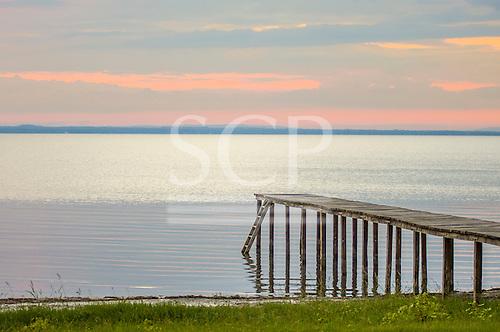 Lake Trasimeno, Umbria, Italy. Pier beside the still lake at dusk.