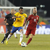 Brazil midfielder Luiz Gustavo (17) on the attack as Portugal midfielder Raul Meireles (16) closes. In an international friendly, Brazil (yellow/blue) defeated Portugal (red), 3-1, at Gillette Stadium on September 10, 2013.