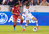 Hilary Jaen #4 of Panama defends Christen Press #20 of the United States