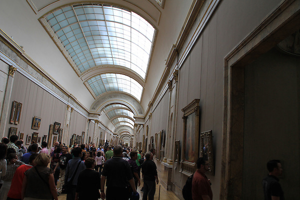 A crowded main gallery in the Louvre Museum in Paris, France.
