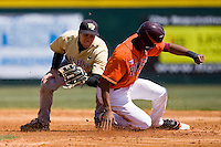 Austin Wates #21 of the Virginia Tech Hokies slides into second base ahead of the tag from Mark Rhine #2 of the Wake Forest Demon Deacons at English Field March 27, 2010, in Blacksburg, Virginia.  Photo by Brian Westerholt / Four Seam Images