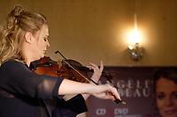 Launch of SOLO labum, by Canadian Violonist Angele Dubeau.<br /> This album celebrate 30 years of the musician professional carrer.<br /> <br /> Lancement de l'album SOLO, de la Violoniste Angele Dubeau.<br /> Cet album célèbre les 30 ans de carrière professionelle de la musicienne<br /> <br /> Toutes les œuvres musicales ont été spécialement choisies par Angèle, commenÌant par L'Arte del violino de Locatelli datée de 1733, année où son célèbre instrument, le Stradivarius Des Rosiers, a été faÌonné. De là un voyage à travers le temps et l'espace qui nous emmène par autant de voies différentes que de compositeurs: époques baroque, classique et romantique, à la musique contemporaine, d'inspiration folklorique, jazz et tango. La sélection inclut la Suite pour orchestre Opus 9 no. 1 de George Enescu, dans une version pour violon seul, trois Ètudes-Tango d'Astor Piazzolla, Divertimento pour violon seul de Campagnoli, et du compositeur canadien Srul Irving Glick, l'oeuvre méditative et poétique Sérénade et Danse pour violon seul. Du grand compositeur et pianiste jazz, Dave Brubeck, on retrouve Bourree pour violon seul, un mariage harmonieux du jazz et du classique, écrite en 1999 et enregistrée pour la première fois par Angèle au Festival International de Jazz de Montréal en 2002. « C'est à cette occasion qu'Angèle m'avait surpris et ravi par son interprétation solo remarquable… » a déclaré Brubeck. On retrouve également sur le CD, narré en franÌais et en anglais par les acteurs Pierre Lebeau et Blair Williams, Ferdinand le taureau, un conte musical pour violon seul et narrateur du compositeur Alan Ridout.<br /> <br /> Musicienne depuis l'âge de 15 ans et ayant un nom connu de tout le pays, Angèle a vendu plus de 300 000 disques en carrière et est l'une des rares solistes canadiennes en musique classique à se voir décerner un Disque d'or pour des ventes record de 50 000 copies en un an. Les riches arrangements sur les récents albums avec l'ens
